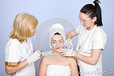 Plastic doctors giving botox shot