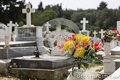 Plastic flowers on a greek cemetery