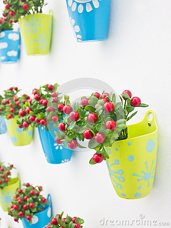 Free Plastic Flowers With Colorful Plastic Vase. Stock Image - 34242191