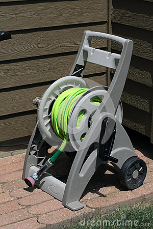 Free Plastic Garden Hose Reel Cart  With Wheels Royalty Free Stock Photo - 32671355