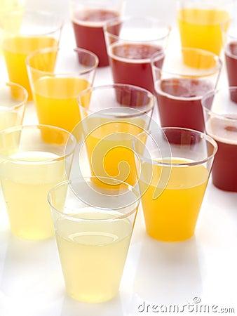 Free Plastic Glasses Full Of Fresh Juice Stock Photos - 24500653