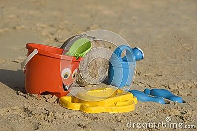 Plastic kids toys on the sand beach