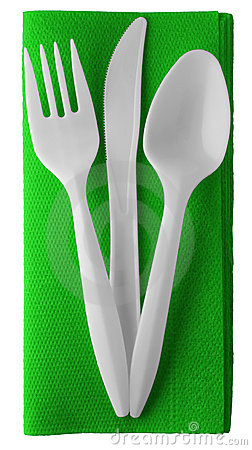 Plastic knife fork and spoon on napkin - isolated