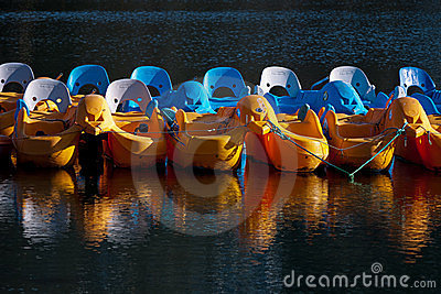 Plastic pedaloes tied up out of season - UK Editorial Image