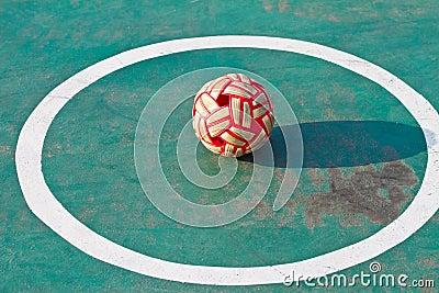 Plastic Sepak takraw ball on the cement floor.