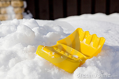 Plastic shovel on snow