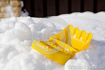 Plastic shovel on snow