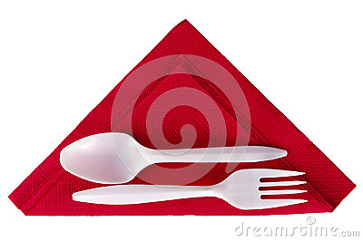 Plastic spoon and fork on red triangle napkin