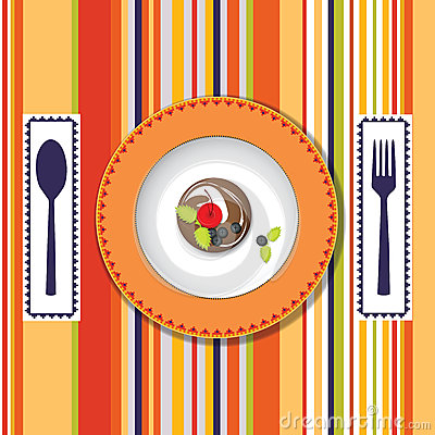 A plate with a cake on the bright background with
