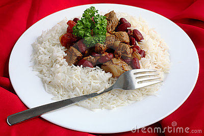 Plate of chili con carne on a red background cloth