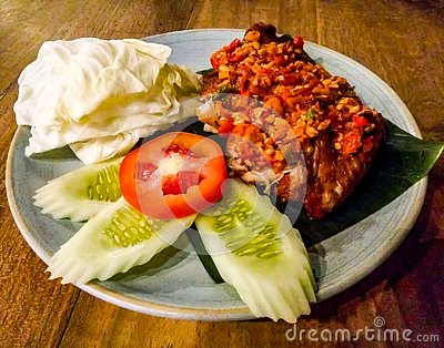 Spicy chicken served on banana leaf Stock Photo