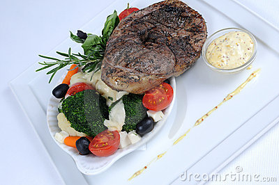 Plate of fine dining meal - lamb with vegetables