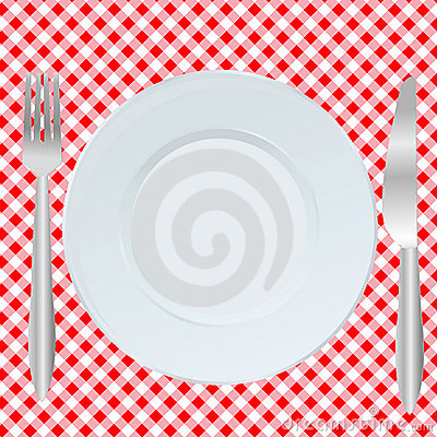 Plate, fork and spoon on  square tablecloth