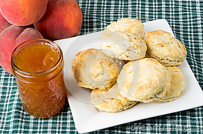 Plate of fresh biscuits with peach jam