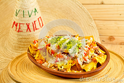 Plate of fresh nachos with a jalapeno cheese sauce