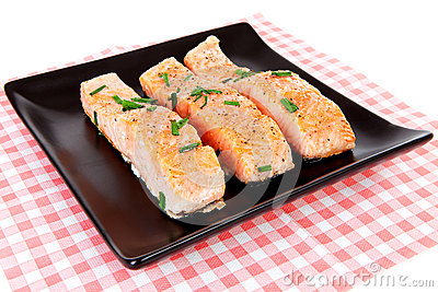 Plate with fresh salmon on checkered napkin