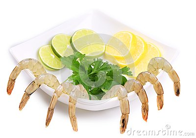 Plate with fresh shrimps and green parsley.