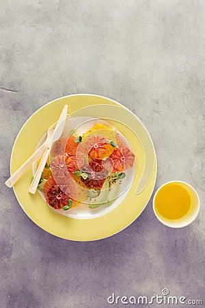 Free Plate Healthy Summer Fruit Salad Oranges Grapefruit Avocado Juic Royalty Free Stock Photos - 116591818