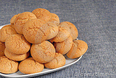 Plate of Italian Amaretti cookies on a blue placemat