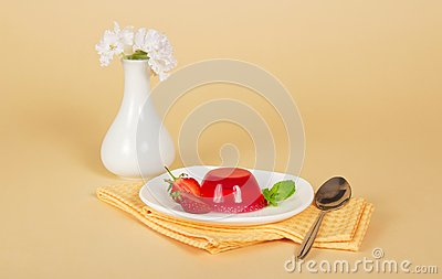 Plate with jelly and spoon on napkin