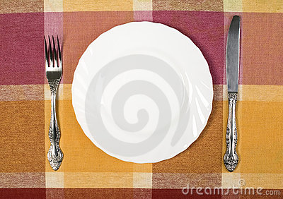Plate with knife and fork on the table