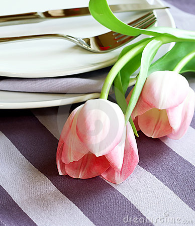 Plate, knife, fork and tulips