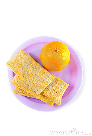A plate with orange  and crisps