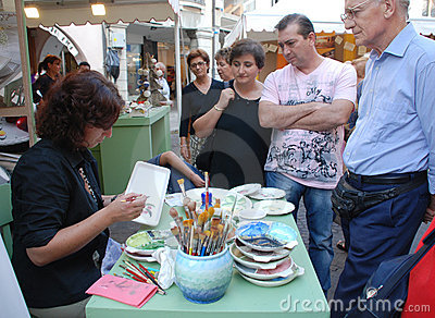 Plate Painter at Friuli Doc Stall Editorial Stock Image