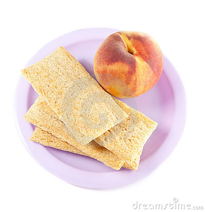 A plate with peach and three crisps