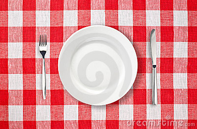 Plate on red checked tablecloth