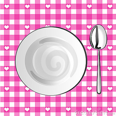 Plate with a spoon on a pink tablecloth