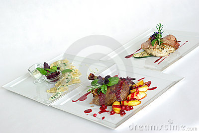 Plates of fine dining meal