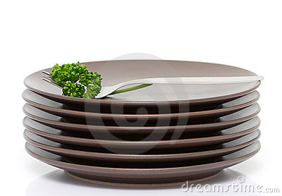 Plates, fork and parsley