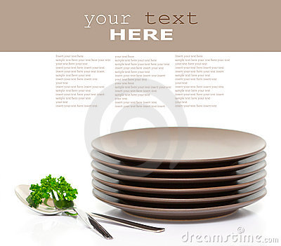 Plates, fork, spoon and parsley