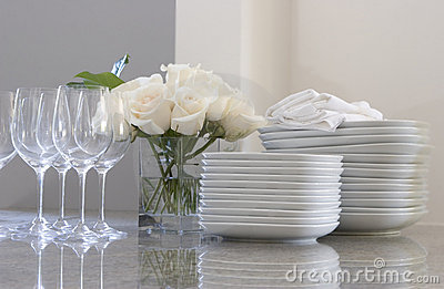Plates, glasses & roses on the counter