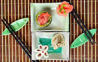 Plates with sushi and dumpling