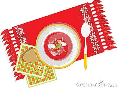 Plato con la sopa vegetal en la servilleta