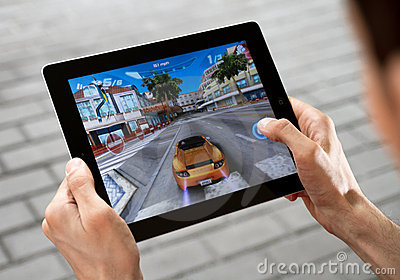 Play Game on Apple Ipad2 Editorial Photography