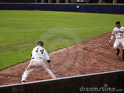 Player dig ball out of dirt and sets to throw Editorial Image