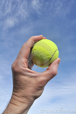 Player Gripping a Yellow Tennis Ball