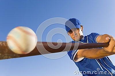 Player Hitting Ball With Baseball Bat Stock Photo