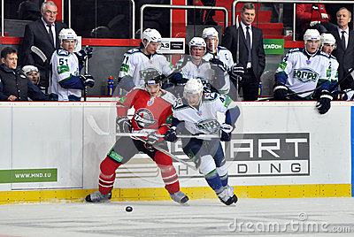 Players from both teams are fighting for the puck Editorial Image