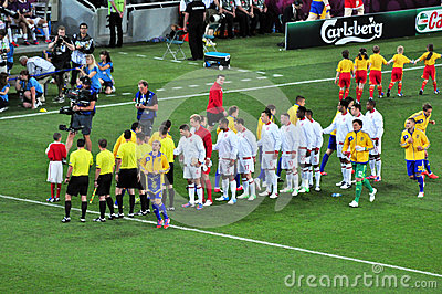 Players from both teams greet each other Editorial Stock Image