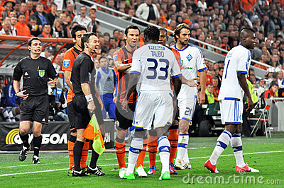 Players from both teams swear on the field Editorial Stock Image