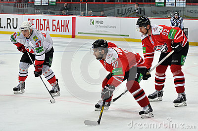 Players from both teams are waiting for the puck Editorial Stock Image