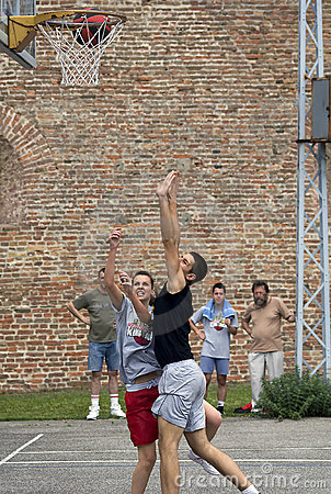 Players follow flight of the ball Editorial Stock Image