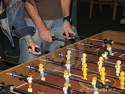 Players at Foosball Table