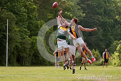 Players Jump For Ball In Australian Rules Football Game Editorial Photography