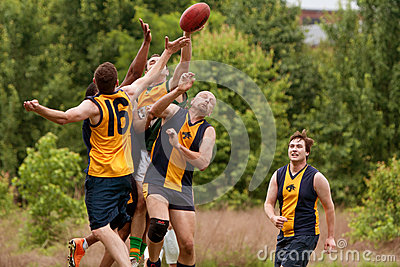 Players Jump To Catch Ball In Australian Rules Football Game Editorial Photo