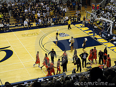 Players run towards bench at start of time out Editorial Stock Photo